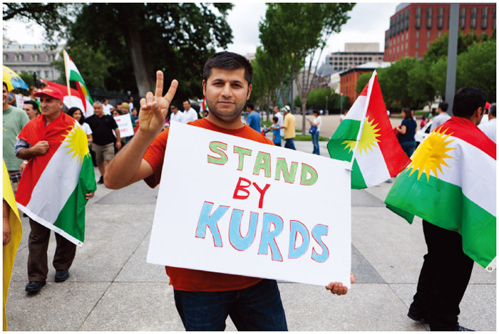 An American Kurd demonstrates in front of the White House.