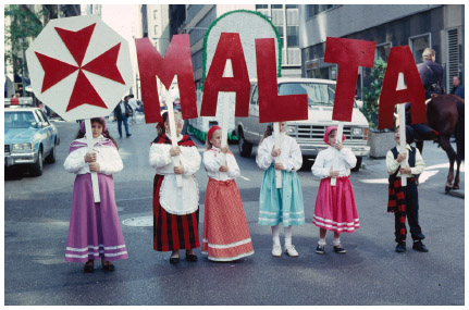 Maltese Americans girls march in a Maltese parade in New York City.