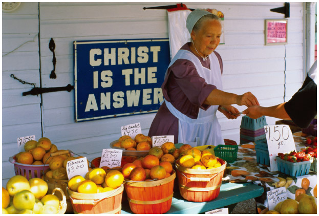 A Mennonite woman works at a produce stand in Sarasota, Florida.
