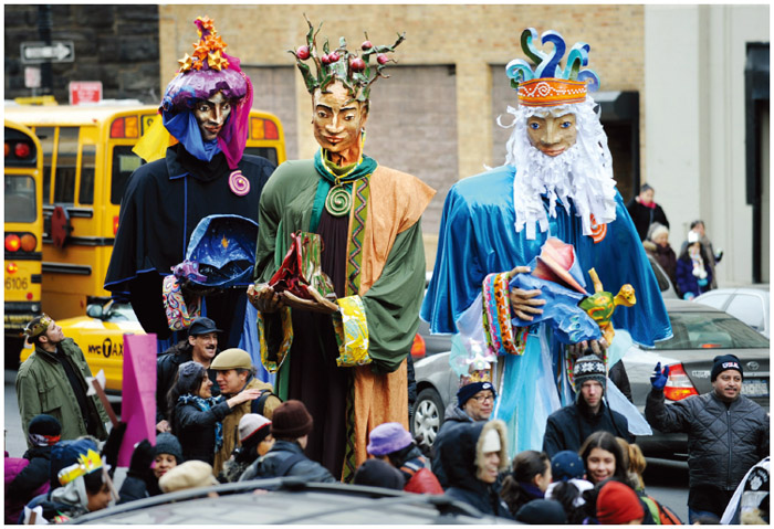 During the 34th Annual Three Kings Day Parade, which celebrates the Feast of Epiphany, giant puppets make their way down East 106 Street in the Spanish Harlem section of New York.