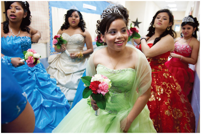 In Langley Park, Maryland, young women wait to make their grand entrance into their quinceanera party. Thirteen young women participated in the Miss Quince Anos Celebration 012 at the Langley Park Community Center. The program features a variety of