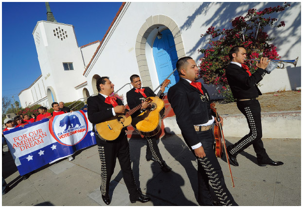 Mariachi musicians go from house to house to encourage people to vote on election day at the Sun Valley's Latino district, Los Angeles County, on November 6, 2012 in California.