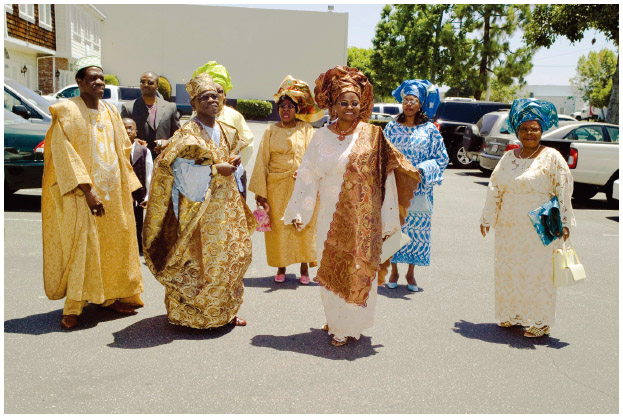 Guests dressed in the ceremonial robes of the Yoruba Tribe arrive at a wedding in Santa Ana, California.