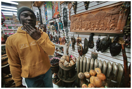 A Nigerian store owner in Harlem, New York.