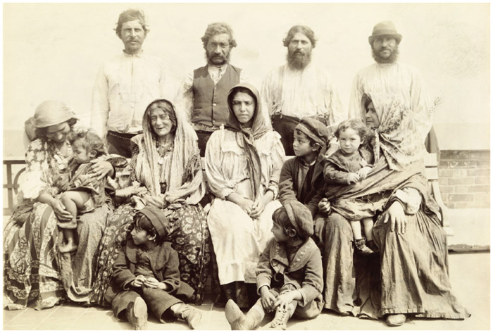 An early portrait of a Romani American family that had emigrated from Serbia.