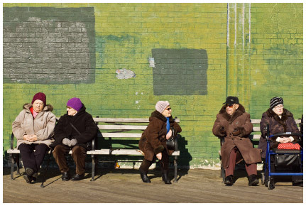 """In Brighton Beach, otherwise known as """"Little Odessa,"""" Russian immigrants enjoy the winter sun. Brooklyn, NYC."""