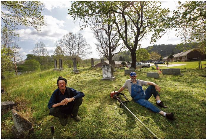 Two Scotch-Irish men take a break while tidying up a graveyard.