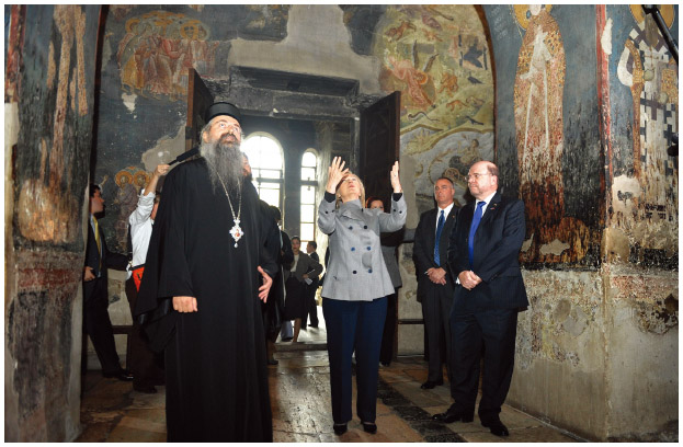 U.S. Secretary of State Hillary Clinton tours the Gracanica Serbian Monastery with Bishop Teodosije (L) and U.S. Ambassador to Kosovo Christopher Dell (R) in 2010.