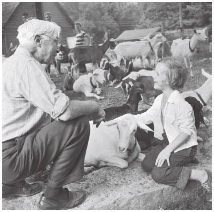 Swedish American poet Carl Sandburg (1878–1967) with his grandchild at his goat farm in North Carolina, c. 1950s.