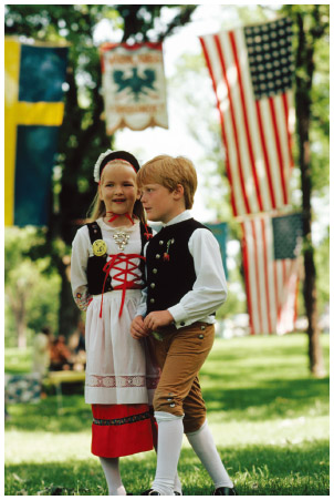 A young girl and boy wear traditional Swedish costumes.