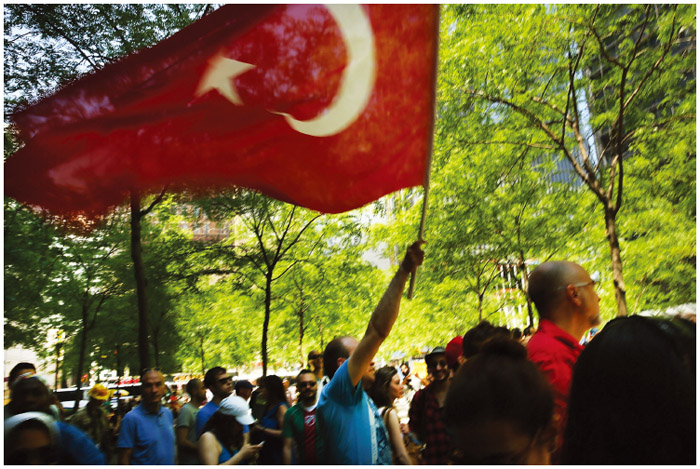 Hundreds of people, including many Turkish Americans and members of the Occupy Wall Street movement, protest in Zuccotti Park, New York City, in solidarity with demonstrators in Istanbul who were trying to stop a popular park from being demolished to