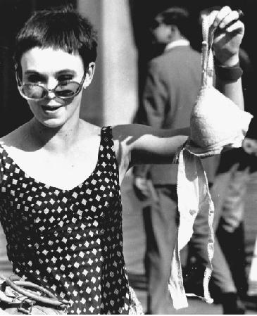 PRIMARY SOURCE Pageant Protest: A member of the Women's Liberation Party drops a bra in the trash in protest of the Miss America pageant, September 7, 1968.