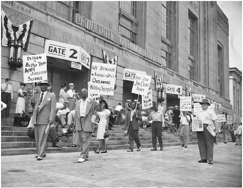 African-American union leader A. Philip Randolph (left) leads picketers outside the Democratic National Convention in Philadelphia, July 12, 1948. They are demanding the Democrats adopt an anti-Jim Crow plank in their party platform.