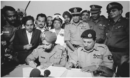 IN A REGION WROUGHT WITH CONFLICT, THERE HAVE BEEN OCCASIONAL SPELLS OF PEACE, LIKE THAT BROUGHT ON BY THIS SIGNING OF A 1971 TRUCE BETWEEN INDIAN AND PAKISTANI OFFICIALS. (Corbis. Reproduced by permission.)