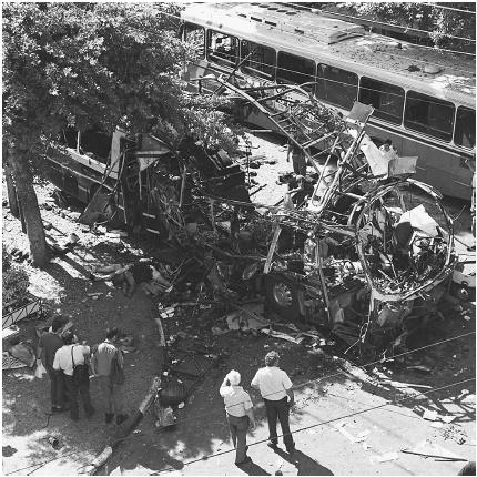 IT IS DIFFICULT FOR MANY PEOPLE TO UNDERSTAND THE MOTIVATIONS BEHIND USING ONESELF AS A HUMAN EXPLOSIVE. YET SUICIDE BOMBINGS SUCH AS THIS ONE ON AN ISRAELI BUS HAVE OCCURRED THROUGHOUT HISTORY. (AP/Wide World Photos/Jerome Delay. Reproduced by permission.)