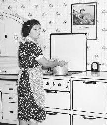 The middle class mom prided herself on making do when feeding her family. She relied on basic foodstuffs to stretch meal portions. (The Library of Congress.)