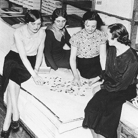 Four women work together on assembling a jigsaw puzzle in the packing room of a Cleveland puzzle manufacturer. Jigsaw puzzles became a popular, inexpensive way to pass the time during the Depression. (APWide World Photos. Reproduced by permissi