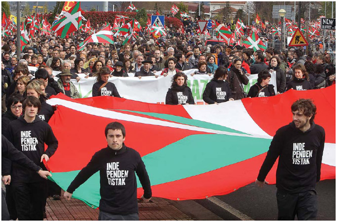 Basque National Flag. Basque people carry the Ikurrina, the Basque National flag, during celebrations marking Aberri Eguna, the Basque peoples annual feast day in Hendaye, southwestern France. An ethnic group that resides