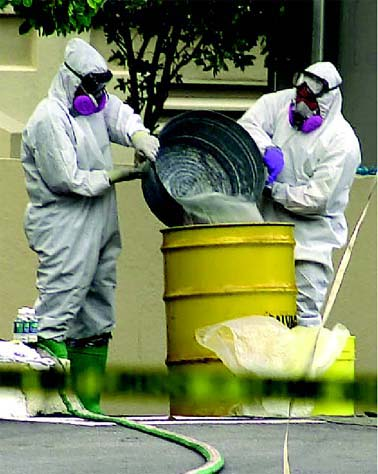 FBI special investigation team members wear hazmat suits as they work to decontaminate the American Media Inc. office in Florida in 2001. The publishing facility became a bio-hazard crime scene following the death of a worker from exposure to