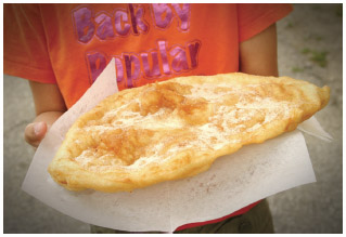 The Midwest is known for its state and county fairs. Various food vendors set up shop at such fairs and offer a wide variety of treats, including a large, fried pastry called Elephant Ears.