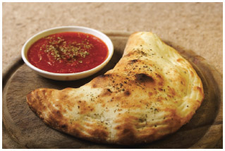 Calzone, a traditional Italian food, is enjoyed by many Americans in the Midwest as well as other regions.