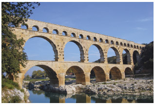 Built in c.14 AD by the Romans, the Pont du Gard aqueduct spans the Gard River and provided the city of Nimes with water.