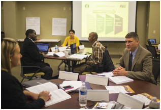 At a government-sponsored workshop, U.S. military personnel who are about to be discharged are given training on how to reenter the workforce in the private sector.