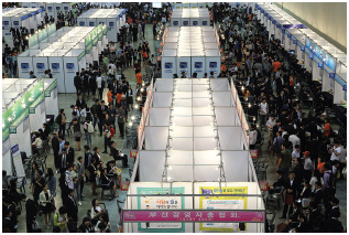Professional networking occurs all over the world, and job fairs like this one in Busan, South Korea, are a good place to interact with other professionals in your field.