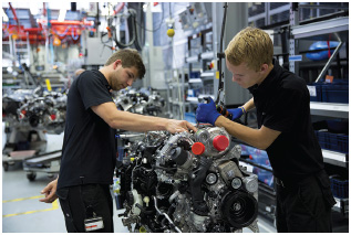 A trainee engineer is supervised while hand building a complete Mercedes-AMG engine in Affalterbach, Germany.