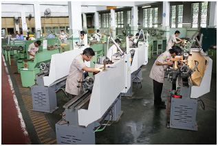 Students working on lathes at the vocational training school ATMI, in Solo, Indonesia.
