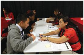 A job seeker is interviewed during a job fair in San Francisco, California.