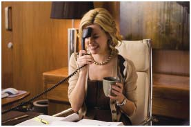 Elizabeth Banks, as Beth, reacts to a stressful phone call in the film Role Models.