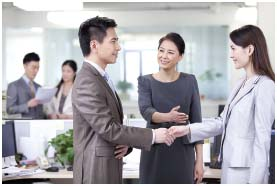 Shaking hands on meeting a new colleague is just one of many forms of workplace etiquette.
