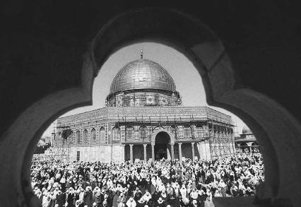 Muslims in prayer near the Dome of the Rock Mosque, Jerusalem
