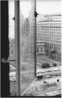 A still smoking presidential palace seen through a bullet-ridden window, during the aftermath of the coup detat in which Army General Augusto Pinochet toppled Chilean President Salvador Allende, September 11, 1973