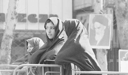 Iranian women wait for the return of the exiled Ayatollah Ruhollah Khomeini in Tehran during the Iranian Revolution, 1979