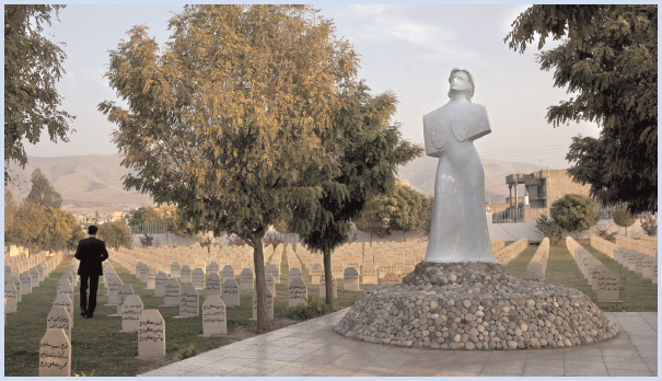 A man walks through the Halabja Memorial Cemetery, where victims of the 1988 chemical weapons attacks against the Kurds are buried.