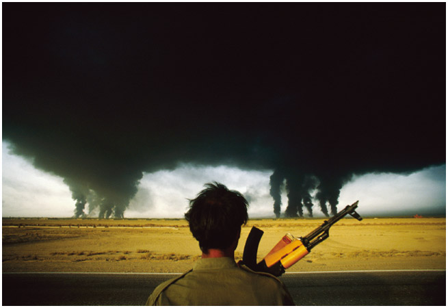 An Iranian soldier watches as smoke rises from burning oil refineries in Iran. While neither Iraq nor Iran gained territory in the Iran-Iraq war, both countries lost resources such as oil.