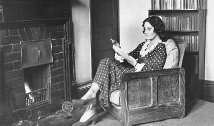A woman reads in a study at Cambridge's Girton College