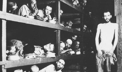 Wiesel (second tier from bottom, raised figure, right) and other prisoners at the Buchenwald Concentration Camp