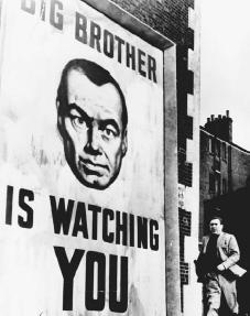 Film still from 1984 (1956), directed by Michael Anderson. George Orwells 1949 novellater transferred to filmtells the story of a totalitarian regime that controls its population through constant governmental surveillance. Adhering to the rules
