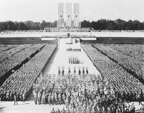 Still from the 1934 German propaganda film Triumph of the Will, directed by Leni Riefenstahl. Nazism, or National Socialism, was similar to Italian Fascism, with some distinctions. Nazism was based on the concepts of military authority and raci