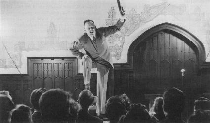 Evangelist Tom Presnell draws a crowd in Chicago with the energetic, fire-and-brimstone style typical of so many preachers during the 1950s.