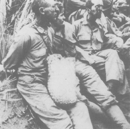 American POWs on the Bataan Death March, Philippines, c. May, 1942.