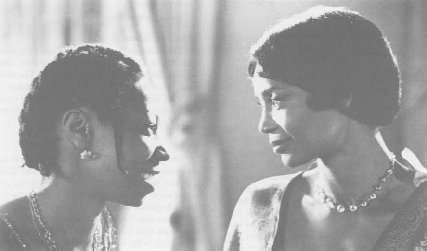 Still from the 1985 movie The Color Purple, starring Whoopi Goldberg (left) as Celie and Margaret Avery (right) as Shug Avery.