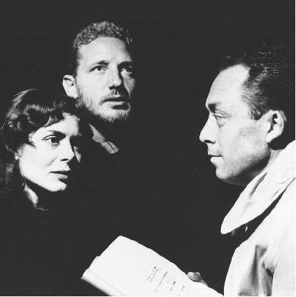 Albert Camus directing actors Catherine Sellers and Marc Cassot in his stage adaptation of William Faulkners novel Requiem for a Nun.
