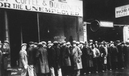 Unemployed men standing in line outside a Chicago soup kitchen during the Great Depression (1931).