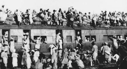 Hundreds of Muslim refugees crowd atop a train leaving New Delhi for Pakistan on the day when British India was divided up into officially Muslim Pakistan and mostly Hindu India, September, 1947