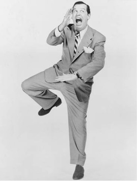 Milton Berle, one of the most popular comedians in the United States during the 1940s and 1950s, specialized in physical comedy, sight gags, and outlandish costumes.