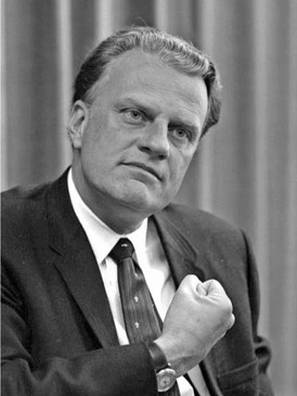 Preaching in person at revival meetings and on radio and television, the Reverend Billy Graham introduced Christianity to millions, emphasizing the conversion experience rather than theology.